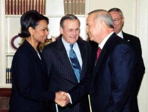 "Former Secretary of Defense Donald Rumsfeld suffers a ""reverse oreo"" moment standing between Condolezza Rice, and Secretary Colin Powell in a recieving line greeting Uzbekestan President Karimov."