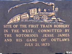 On July 21, 1873, Jesse James and the James-Younger Gang robbed their first train in Adair, Iowa, of all places. They managed to derail the Rock Island train, turning the train on its side, killing the engineer and injuring a lot of its passengers. But that wasn't enough terror for the passengers - the James-Younger Gang, clad in Ku Klux Klan garb, went up and down the length of the overturned train confronting them and demanding their watches and valuables (although some reports say they stole only from the men). They threw it all in bags along with the money from the train's safe and ended up getting about $3,000.