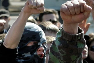 Russian Paramilitary Nationalist and Skinhead Groups Frequently Attack Foreigners and Minorities